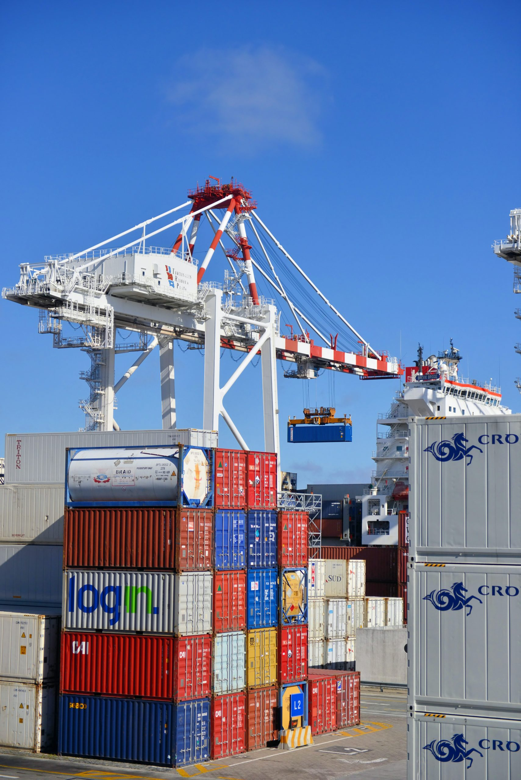 A crane moves shipping containers.