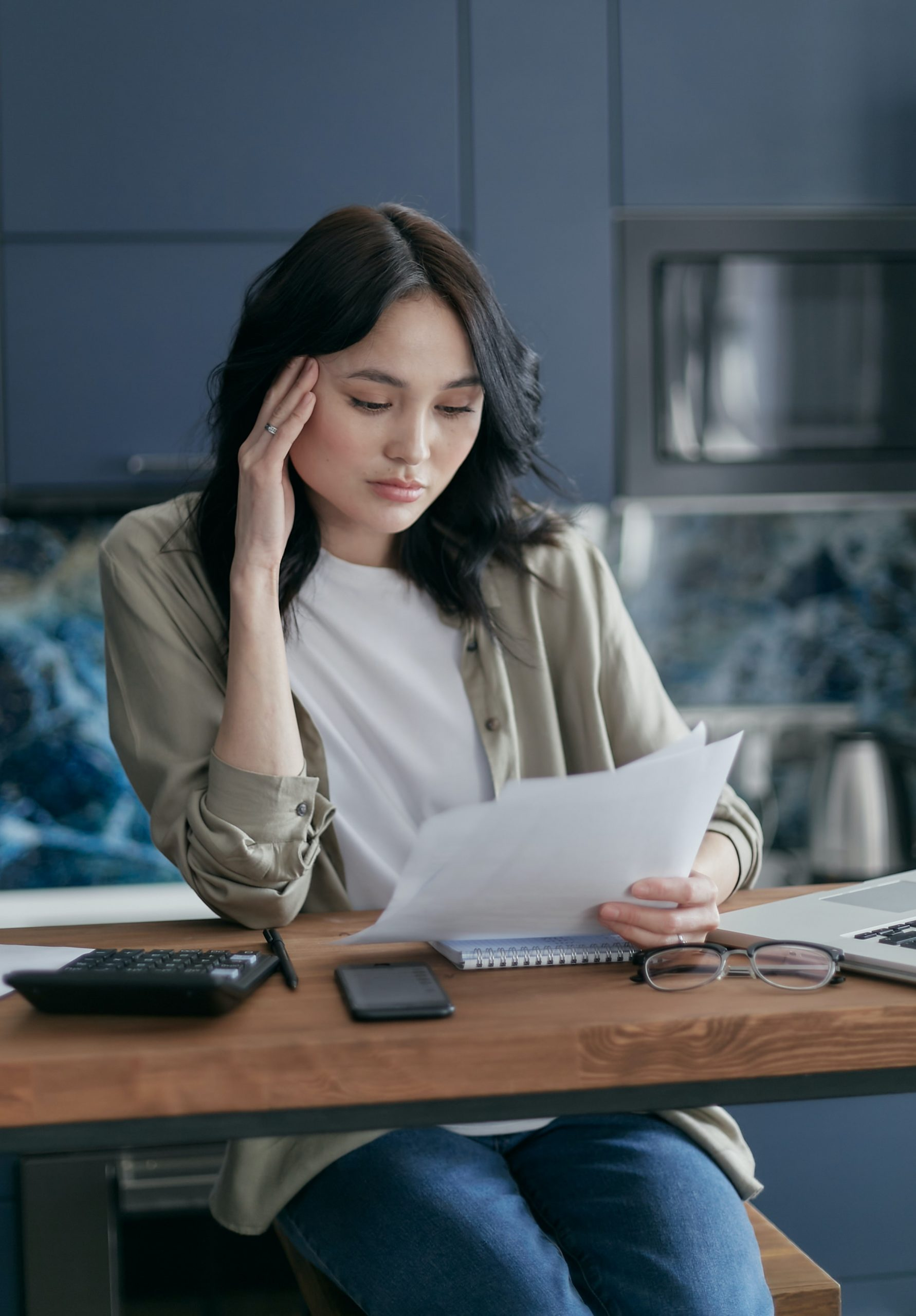 woman stressed from debt collection
